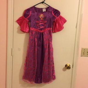 Girls beautiful Disney Dress. Size 5/6 .